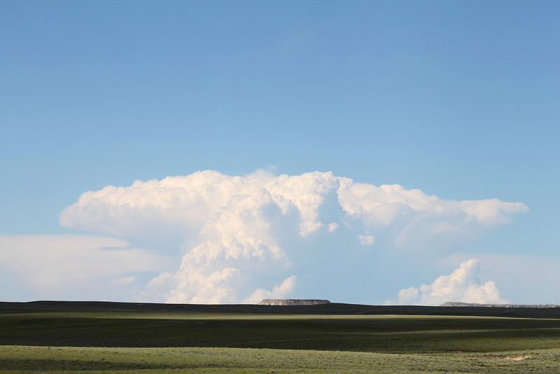 Cumulus cloud over Dishpan Butte and Beaver Rim
