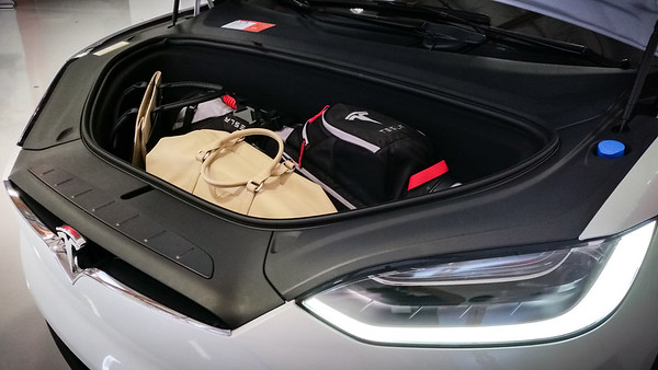 I'm always amused by how much usable cargo space there is when your vehicle does not need an internal combustion engine.  The frunk is larger than the trunk in Valerie's convertible MINI...and I'm guessing its volume is similar to my NSXs.