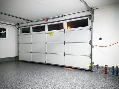 New floor is in!  Can't walk on it yet...or close the garage door