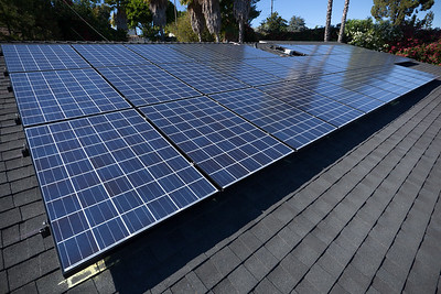 I head up on the roof to inspect our 39 solar panels.