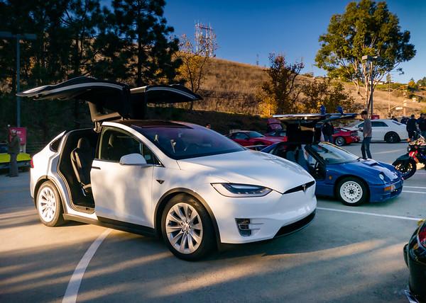 I move my Tesla Model X next to Ashley's Autozam AZ-1