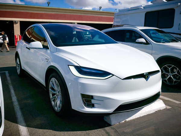 I almost fainted when I heard how expensive the OEM Contis were going to cost through Tesla since the set only lasted around 17,000 miles.  I immediately started researching my alternatives and, as usual, America's Tires had a much more reasonable option.