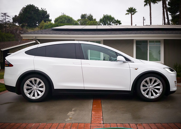 When the car sits low, Model X doesn't look much like an SUV...more like a vertically extended Model S.