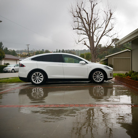 Since I knew it would be raining during my morning commute, you'd think I would have parked the X facing the other way, closer to the garage, and that I wouldn't have left my umbrella in the car when I got home last night #WetCommute #ThunderstormThursday #NeverRainsItPours #Tesla #ModelX