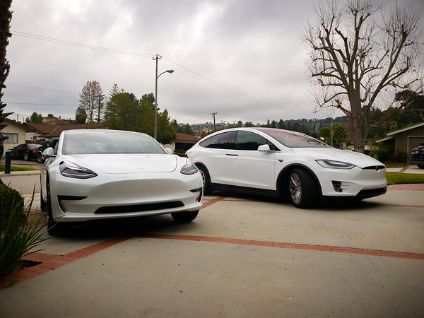 JANUARY - Today's forecast: one of these cars will get wet. The other gets to stay dry in the garage. And we took our Christmas lights down just in time... #Tesla #Model3 #ModelX #Happy2019