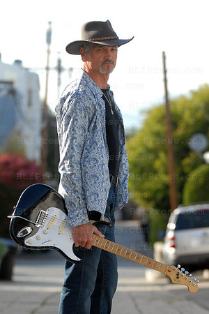 XAVIER J. NATHAN  POSES IN SANTA MONICA WITH HIS GUITAR FENDER.