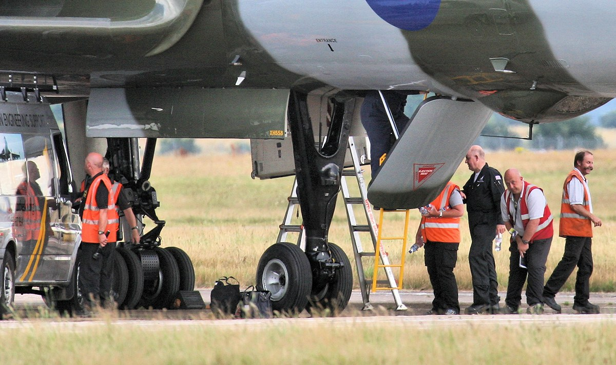 Back on stand, and the ground crew get to work............<br /> By Jim Calow.