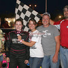 "Miranda Arnold of Sedalia celebrates her first ""Mr. G's Night at the Races' hobby stock feature victory at Double-X Speedway.  Representing Mr. G's and presenting the trophy is Missy Gerhart of California MO.  Also pictured is Double-X Speedway director of competition Kevin Hill also of California. Photo by Carol Wirts of Double-X Speedway - California MO"