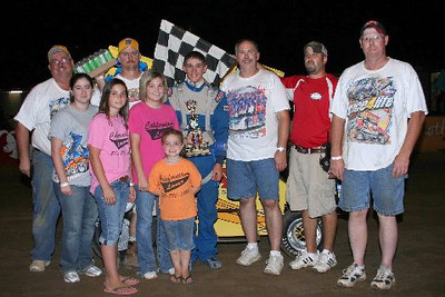 Cole Melby of Sedalia MO is joined by family and crew members at Double-X Speedway Sunday night as he claims his 600cc Micro Midget feature trophy.