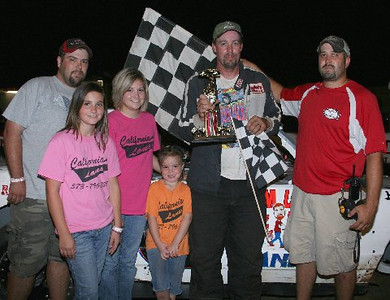 John Clancy, Jr. of California MO and crew member accept the Double-X Speedway Street Stock Feature from Sierra Arrowwood and Shelby & Zoie Rimel all of California and representatives of 'California Lanes.