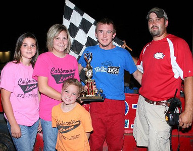 Luke Skidmore of Green Ridge MO claims his Hobby Stock feature trophy Sunday night at Double-X Speedway.  Also pictured are trophy girls Sierra Arrowwood and Shelby & Zoie Rimel of California Lanes and track official Kevin Hill.
