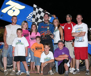 """Race fans join Tyler Blank of California MO as he claims his second 2009 Double-X Speedway trophy on """"California Lanes Night at the Races"""" last Sunday night!"""