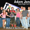 Photo by -Double-X Speedway track photographer - Carol Wirts<br />  <br /> Adam Jones of Wright City, MO celebrates his 360 winged sprint victory with his father Dennis (front right), crew members, and California MO Sonic girls.