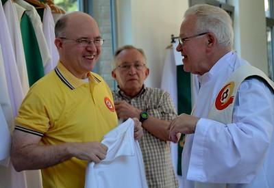 Fr. Steve, Fr. Claude and  Fr. Bill vest for Mass