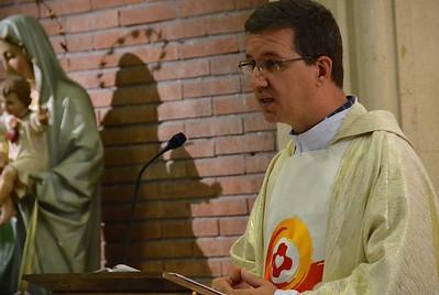 Fr. Carlos Enrique proclaims the Gospel