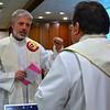 Fr. Stefan and Fr. Jack work out last minute liturgical details.