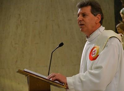 Fr. Mariano reads the Gospel