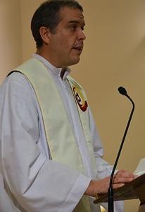 Fr. Carlos Suarez reads the Gospel