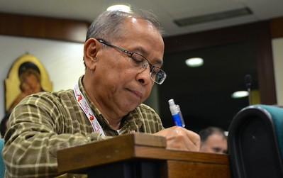 Fr. Sugino fills in his ballot