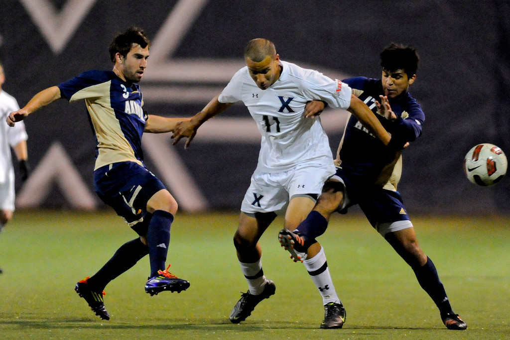 Xavier (11) Luke Spencer (middle) fights for the ball with Akron (3) Chad Barson (left) and Akron (17) DeAndre Yedlin during the game between the Xavier Musketeers and Akron Zips Cincinnati, Ohio.  Xavier and Akron ended in a draw (1-1).