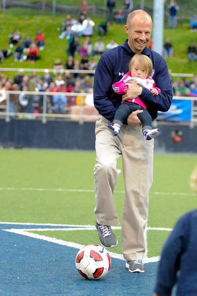 Xavier head coach Andy Fleming with his daughter Devin before the First Annual Down Syndrome Awareness Spring Classic the game between the Xavier Musketeers and Akron Zips Cincinnati, Ohio.  Xavier and Akron ended in a draw (1-1).