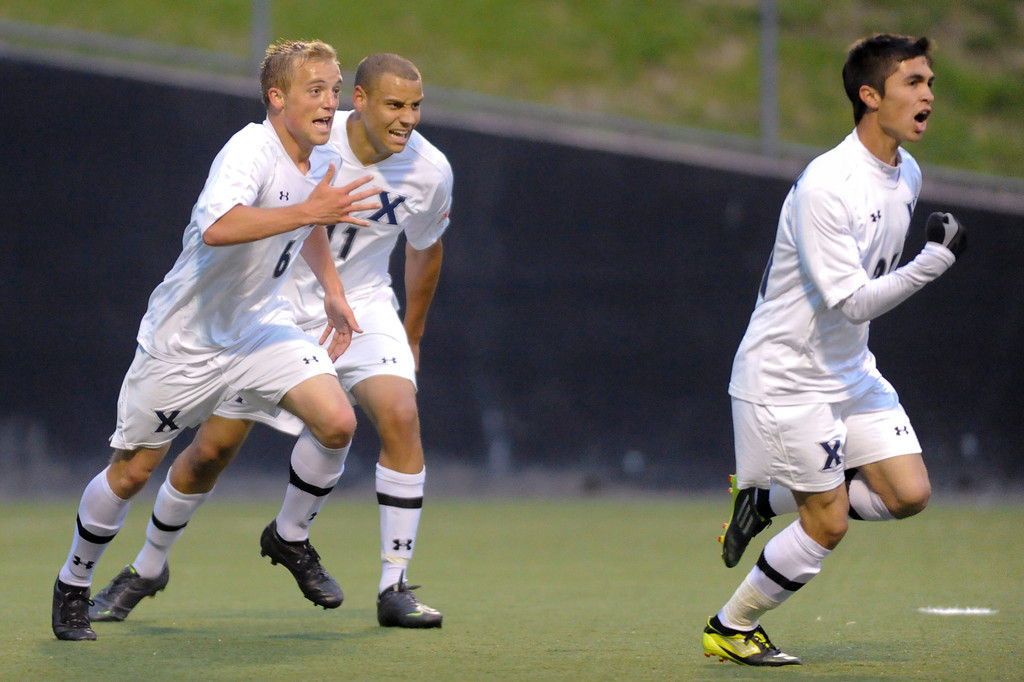 Xavier (21) Gino Depaoli (right) celebrates with teammates after scoring the Tying goal during the game between the Xavier Musketeers and the Akron Zips Cincinnati, Ohio.  Xavier and Akron tied 1-1.