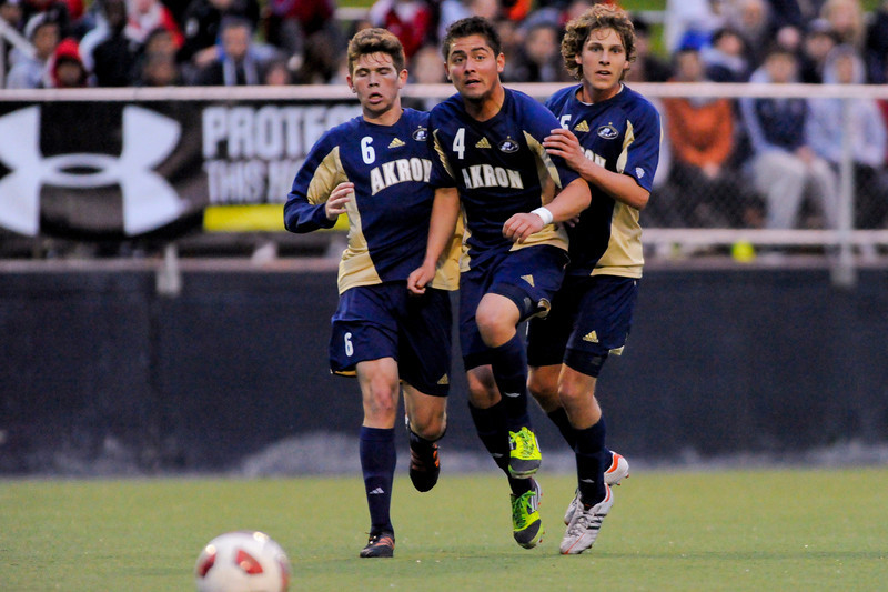 Akron's (6) Wil Trapp  (4) Bryan Gallego and (15) Scott Caldwell during the game between the Xavier Musketeers and Akron Zips Cincinnati, Ohio.  Xavier and Akron ended in a draw (1-1).