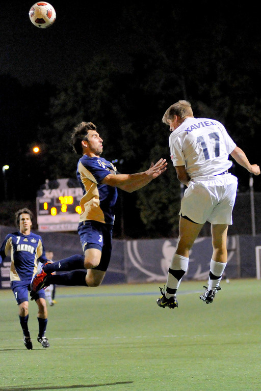 Xavier (17) Nick Hagglund with a header over Akron Chad Barson during the game between the Xavier Musketeers and the Akron Zips Cincinnati, Ohio.  Xavier and Akron tied 1-1.