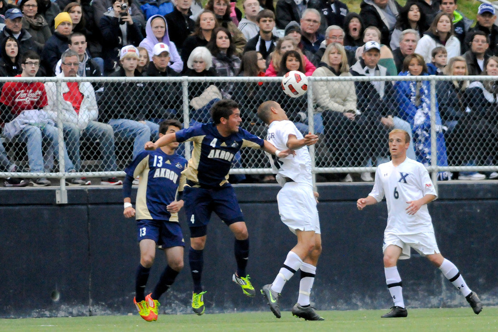 Xavier (17) Nick Hagglund (right) heads the ball over Akron (4) Bryan Gallego during the game between the Xavier Musketeers and Akron Zips Cincinnati, Ohio.  Xavier and Akron ended in a draw (1-1).