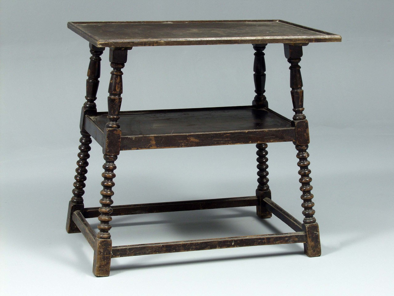 Side table with dressing on.