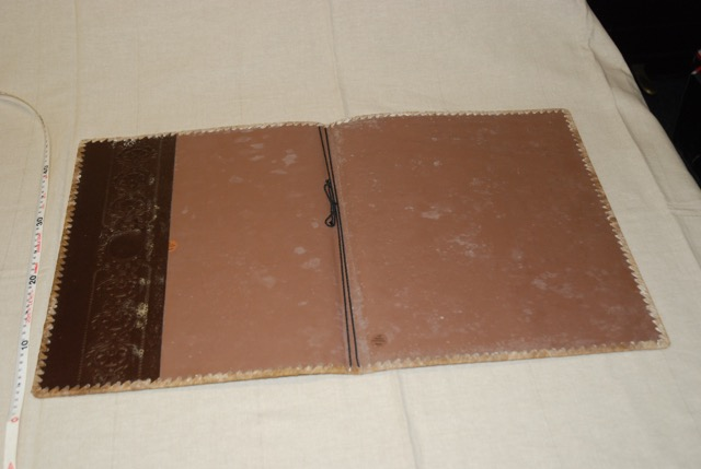 Option for folder Dominic carries the manuscript in - inside.