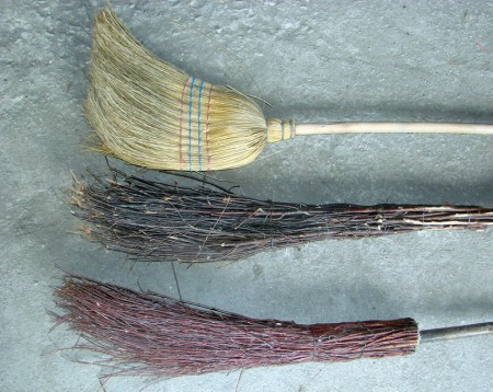 Mops and brooms for cleaning floor.