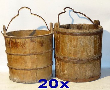 Buckets for monk to carry or full of water for cleaning floor.