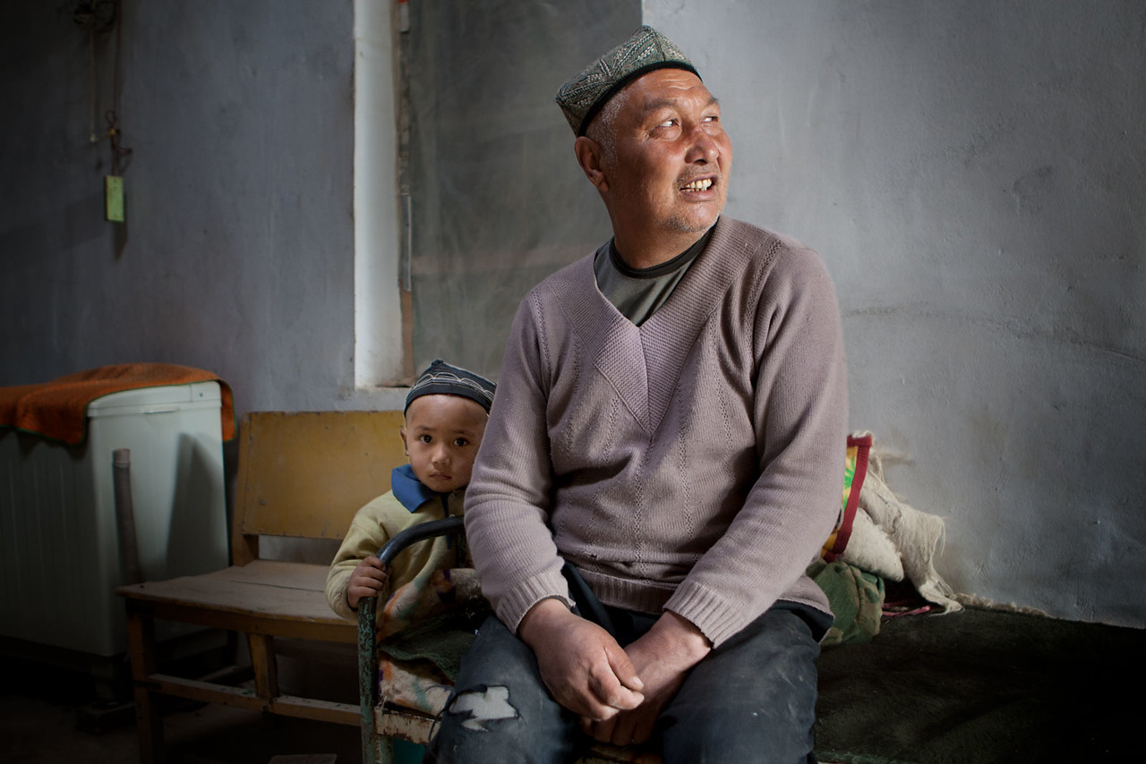 Man and grandson. Charklik / Ruoqiang.