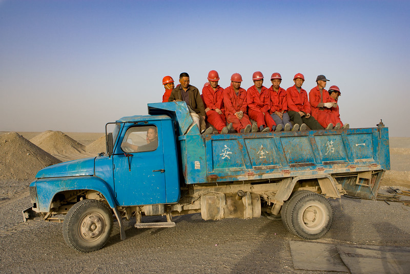 Road workers in the desert. Miran.