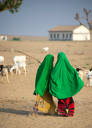 Two young Somali girls walking to school in rural Somalia