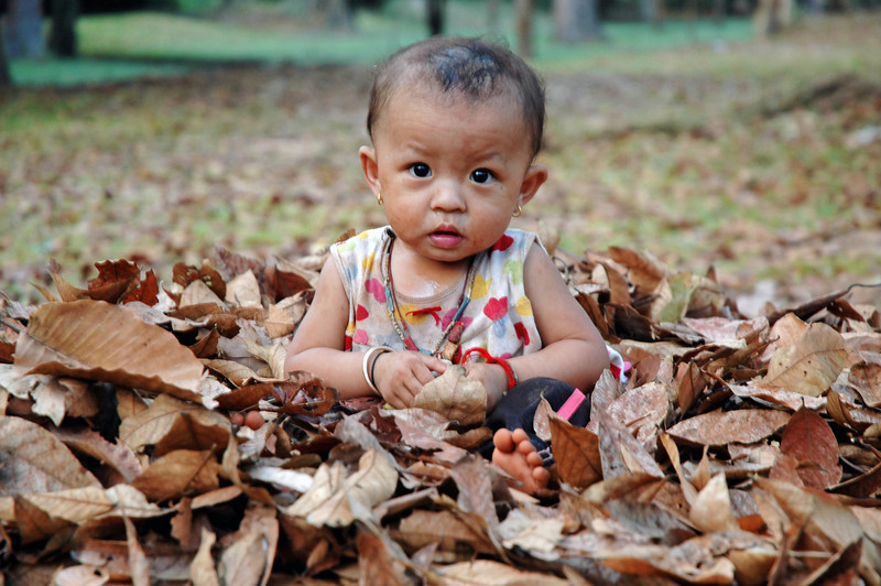 I was biking home at the end of another very long day of temple hoping around Angkor, Cambodia when i saw this little girl playing in the leaves. I ripped on my brakes, spun around and threw the bike in the dirt on the side of the road, and ran over to her to take the shot before the moment passed.  Its random  moments like these that inspire me the most, and make lugging a heavy camera around in 30+ degrees all worth it.