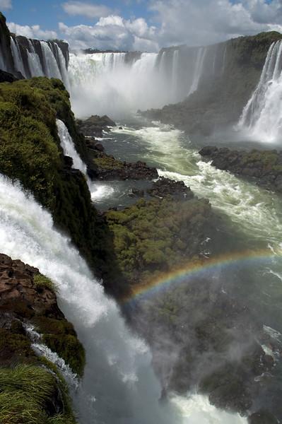Rainbow in the spray at Iguazu waterfall Brazil