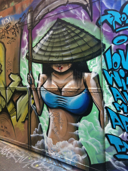 Graffiti of a Girl Ninja holding a sickle