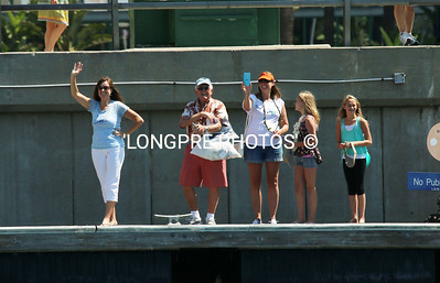 VARNUA family and friends waving goodbye from dock.