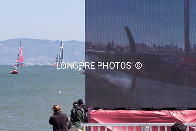 Photo is of the Jumbo Tron on right side and the actual image on left of what is seen on Jumbo Tron.
