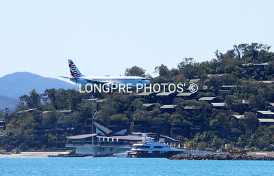 Virgin Australia plane landing right over Hamilton Island Yacht Club.