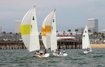 2 Spinnakers running toward Balboa pier.  Newport Beach, CA