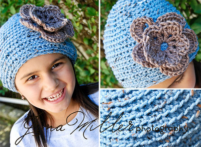 Blue-flecked crocheted cap with a two-layer mocha colored flower.