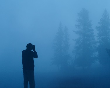 Photographer in the fog [September; Yellowstone National Park, Wyoming]