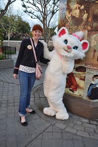 Melinda Becker, Kansas, strikes a pose with a Disney character