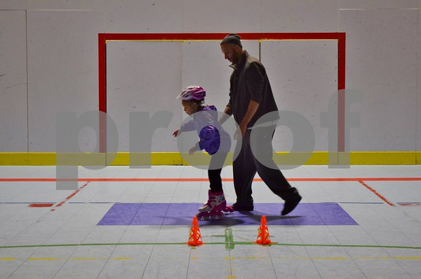 Tim Didier of Buffalo Grove and his 5-year-old daughter Jordyn attended the Spring Break Skate event on March 29 at Kishwaukee Family YMCA in Sycamore. The event was part of the Y's new roller skating program, which started in October and runs through May 27.