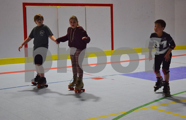 Regan Ni of DeKalb, 10, (right) made friends and skated with brother and sister Aidan Didier, 12, and Sydney Didier, 10, both of Sleepy Hollow, during the Spring Break Skate event at the Kishwaukee Family YMCA in Sycamore.