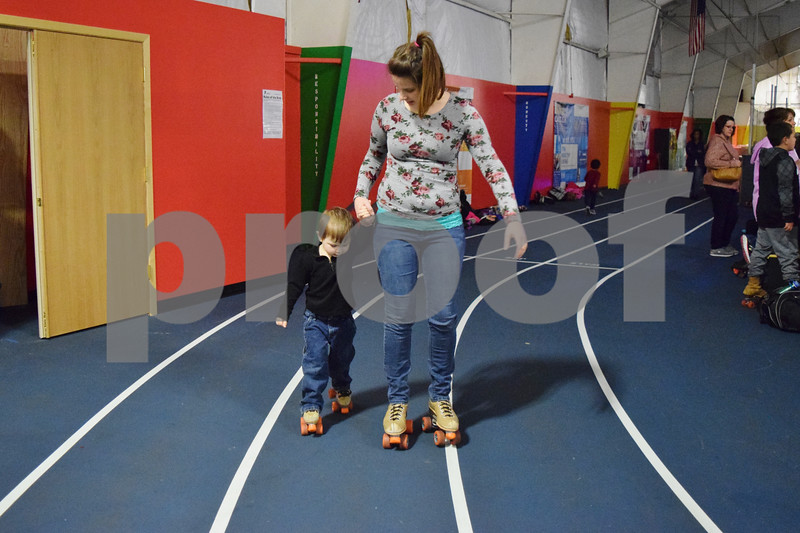 Jen Cook of DeKalb and her 3-year-old son John Heffner roller skated for the first time on March 29. They attended the Spring Break Skate event at the Kishwaukee Family YMCA, 2500 W. Bethany Road in Sycamore. The event was part of the Y's new roller skating program, which started in October and runs through May 27.