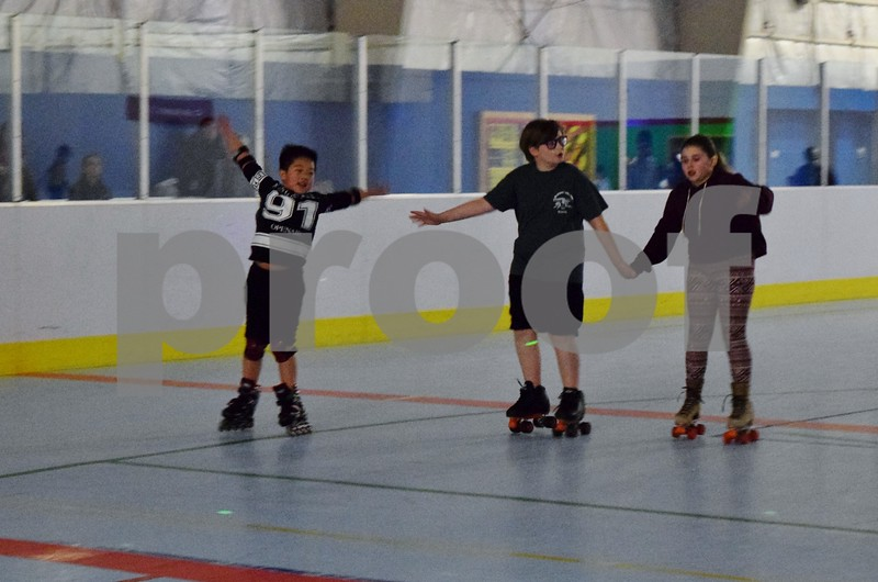 Regan Ni of DeKalb, 10, (from left) made friends and skated with brother and sister Aidan Didier, 12, and Sydney Didier, 10, both of Sleepy Hollow, during the Spring Break Skate event at the Kishwaukee Family YMCA in Sycamore.